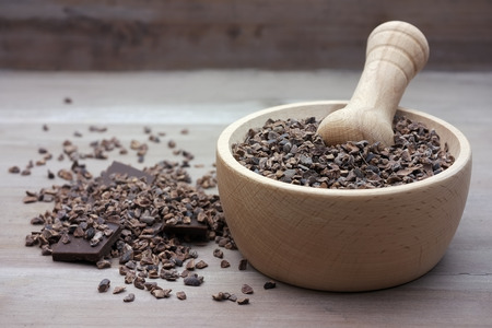 Cacao nibs chocolate in pestle photo