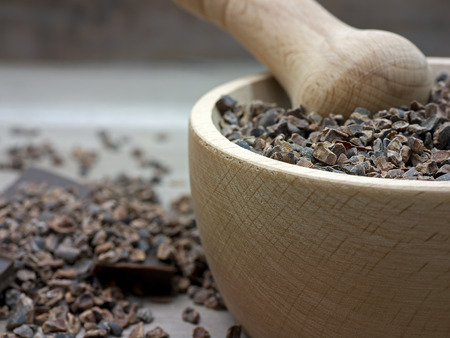 Cacao nibs raw superfood in pestle photo