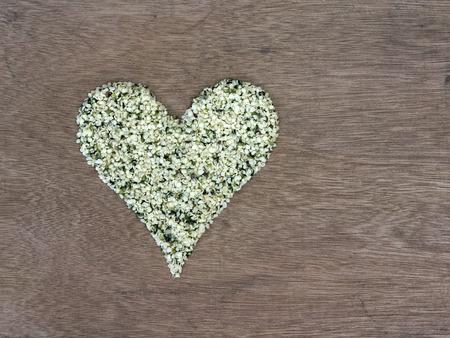 hemp hemp seed: Shelled hemp seeds shaped in a heart symbol