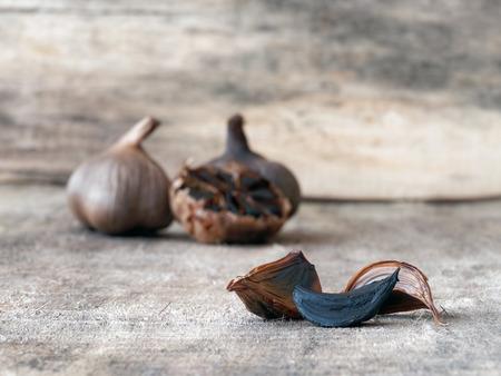 fermented: Fermented black garlic bulbs and cloves Stock Photo