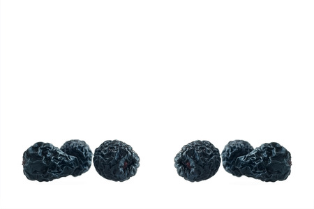 Dried aronia berries isolated on white photo