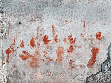Bloody hands and smudges painted on old wall photo