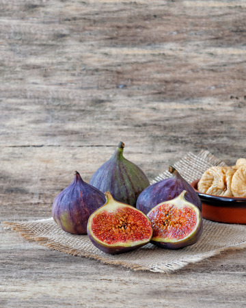 purple fig: Fresh figs cut in half, whole and dried