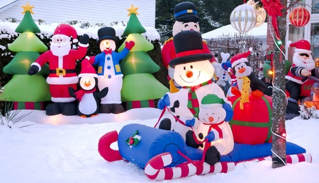 Urban Christmas scene of a home decorated with festive cartoon characters  photo