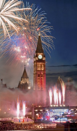 during the day: The canadian Parliament during the fireworks display on Canada Day in July  Editorial