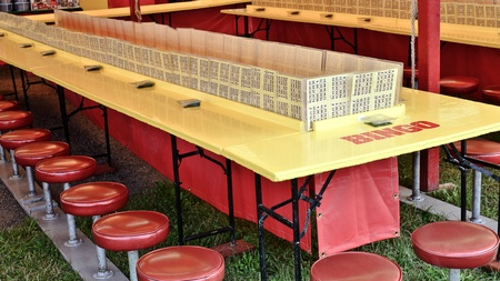 Bingo tables and stools at the state fair in summer