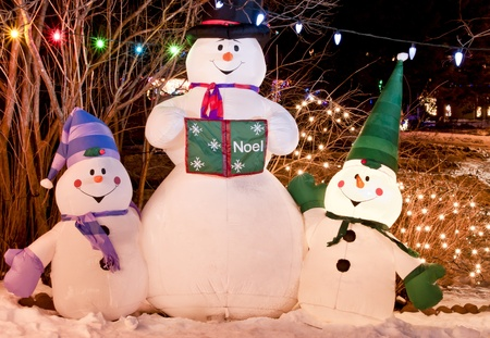Three snowmen are lit up for the Holiday Season. photo