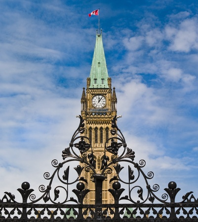 The canadian Parliament Centre Block seen behind the main entrance gate  photo