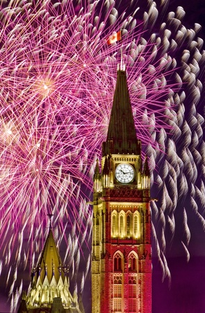 The canadian Parliament Centre Block surrounded by fireworks during the Canada day fireworks display