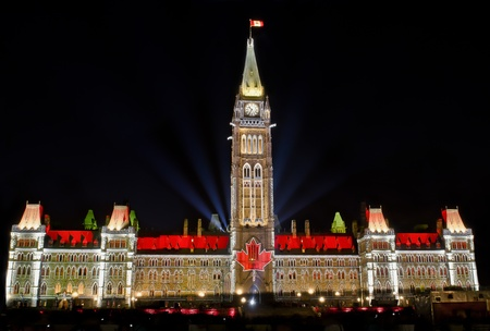 The Canadian Parliament Centre Block light show featuring the maple leaf flag at night