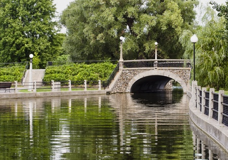 weeping willow: A small stone bridge on the Rideau canal in Ottawa, Canada during summer  Stock Photo