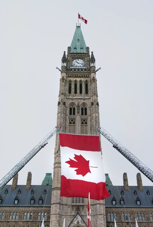 The canadian Parliament Centre block with canadian flags during a celebration  Stock Photo