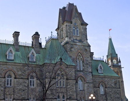 The canadian Parliament West block in the foreground and the Centre Block clock  photo