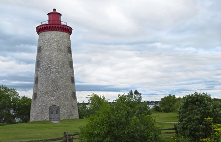Country stone lighthouse surrounded by greenery Stock Photo - 13295105