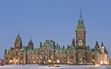 The canadian Parliament East Block in winter with the Centennial flame in the centre  photo