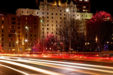 A night shot of car light trails on the street  Stock Photo - 13289629