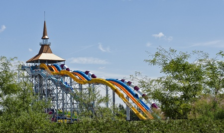 High speed waterslides with 4 person toboggan boats  yellow slide  at a  Waterpark in Canada