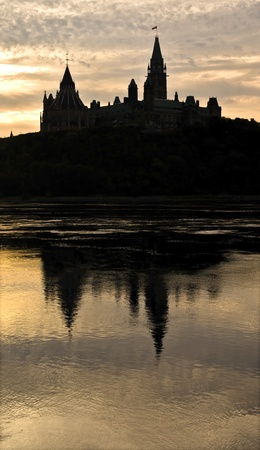 The canadian Parliament reflecting in the Ottawa river at sunrise