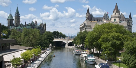 The canadian Parliament, the Fairmont Chateau Laurier hotel and the Rideau canal in Ottawa, Canda