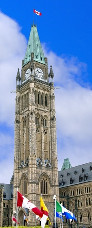 The canadian Parliament Peace Tower with provincial flags