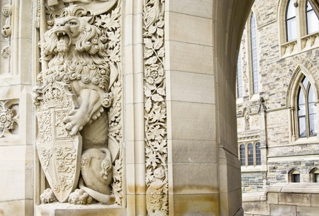 A lion welcomes you at the entrance of the canadian Parliament Centre Block  Stock Photo