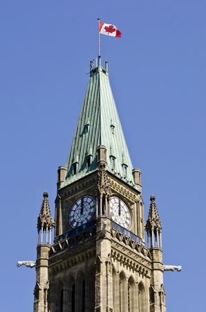 commons: The canadian Parliament Peace Tower with flag at noon in Ottawa Canada