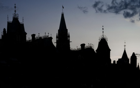 The canadian Parliament East and Centre blocks in silhouette against a blue twilight sky  photo