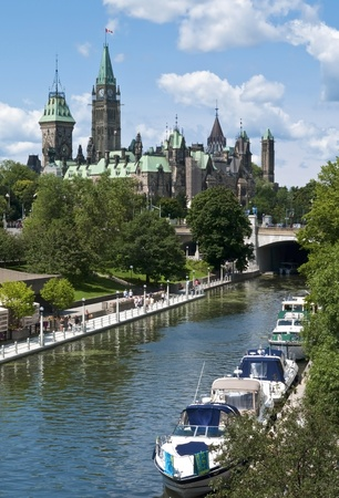 Yachts mooring on the Rideau Canal below the Parliament Centre Block in Ottawa Canada