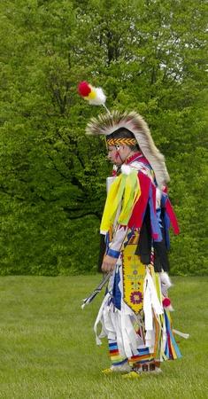 regalia: OTTAWA, CANADA - MAY 28  Unidentified aboriginal man dances in full dress and head regalia during the Powwow festival at Ottawa Municipal Campground in Ottawa Canada on May 28, 2011