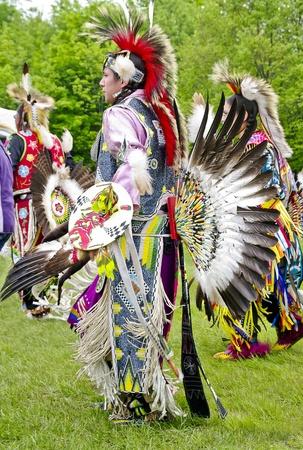 regalia: OTTAWA, CANADA - MAY 28  Unidentified aboriginal men and women dancers in full dress and head regalia during the Powwow festival at Ottawa Municipal Campground in Ottawa Canada on May 28, 2011   Editorial