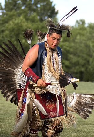 OTTAWA, CANADA - JUNE 16  Unidentified indian dances in full dress at the PowWow festival at Dows lake in Ottawa Canada on  June 16, 2007  Editorial