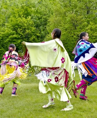 OTTAWA, CANADA - MAY 28  Unidentified aboriginal women dancers in full dress regalia during the Powwow festival at Ottawa Municipal Campground in Ottawa Canada on May 28, 2011