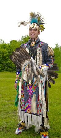 canada aboriginal: OTTAWA, CANADA - MAY 28  Unidentified aboriginal man in full dress and head regalia during the Powwow festival at Ottawa Municipal Campground in Ottawa Canada on May 28, 2011