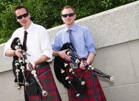 Bagpipe duo relaxing between songs as they entertain tourists in Ottawa, Canada. photo