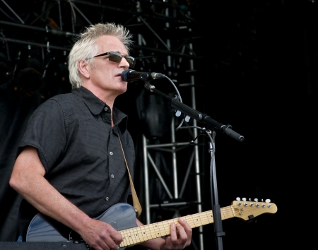 Guitarist/Signer, Brad Campbell of the Yohawks playing BluesFest. Stock Photo - 13731448