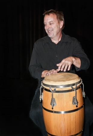 bongo drum: Percussionist René Fortier playing the National Art Centre in Ottawa, Canada. Stock Photo