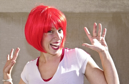 Young woman sporting a red bob for the Canada Day celebrations in Ottawa. Stock Photo - 13731464