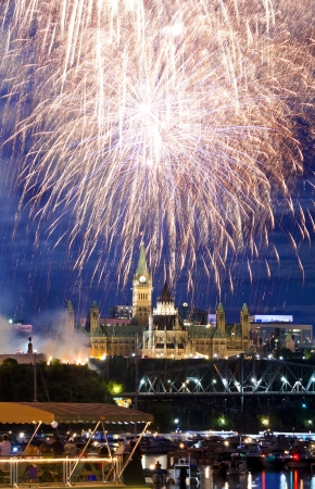 The canadian Parliament in all its glory surrounded by fireworks during the Canada Day celebrations  photo