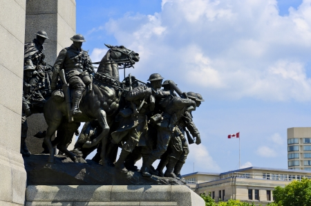 remembrance day: The National War Memorial  also known as The Response , is a granite cenotaph with bronze sculptures, that stands in Confederation Square, Ottawa, Canada and serves as the federal war memorial for Canada