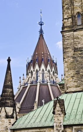 The peak of the Library of Parliament architecture with weathervane, behind the Centre block