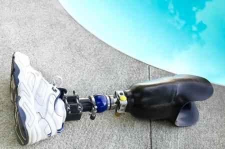 A prosthetic leg left beside the swimming pool