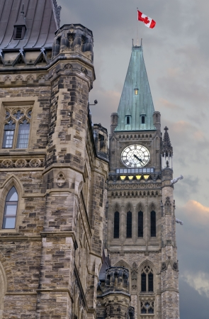 The canadian Parliament on a summer afternoon with angry clouds