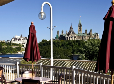 The canadian Parliament Centre block and Library seen from a patio across the Ottawa river  photo