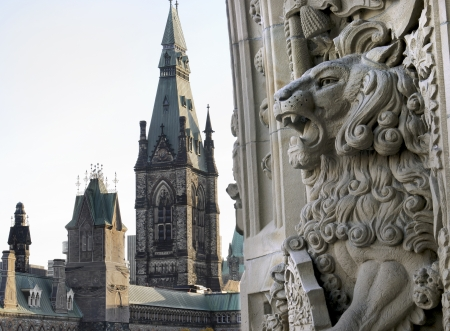 A lion gargoyle welcomes you to the canadian Parliament buildings entrance in Ottawa, Canada  Stock Photo