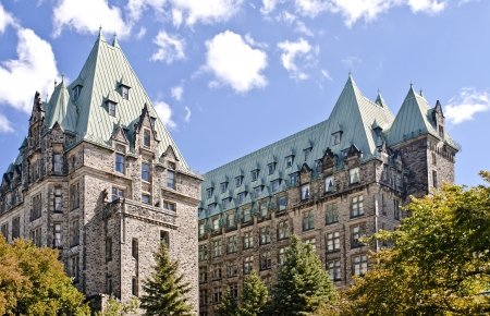 The Canadian Parliament Confederation Building seen from behind showing the 2 towers of offices for Members of Parliament in Ottawa, Canada