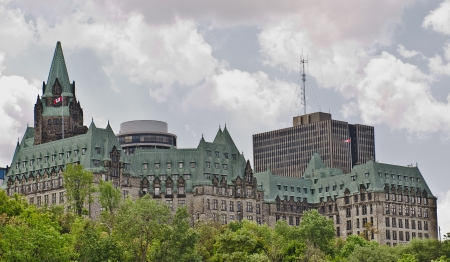 The canadian Parliament Confederation Building facing the Ottawa river in Ottawa, Canada