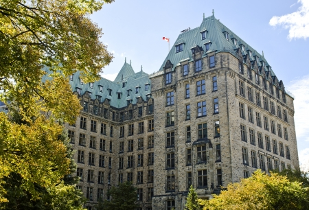 The canadian Parliament Confederation Building shown from behind seeing all three sides