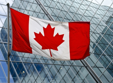 The Canadian flag against a high rise building in downtown Ottawa, Canada