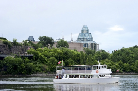 The National Gallery of Canada overlooking a cruise ship on the Ottawa river.