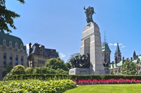 The National War Memorial, known as The Response stands proud in front of the Canadian Parliament East and Centre Blocks in Ottawa.
